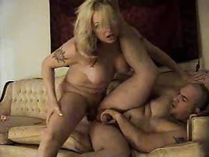 Tattooed blonde shemale whore fucks male